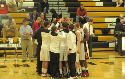 Boys basketball picks up first win of the year