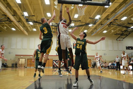 Huntley player attempts to score agianst Crystal Lake South's defense (M. Krebs).