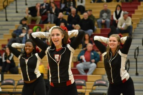 Girls from the varsity pom team perform their hip hop routine during half time (M. Krebs).