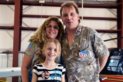 Husband Scott Jensen, wife Susan Jensen, and daughter Kaila Jensen pose for a family photo at Newt Gingrich's presidential rally in LITH (M. Krebs).