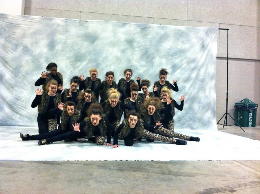 The+Huntley+poms+team+poses+for+their+group+shot+