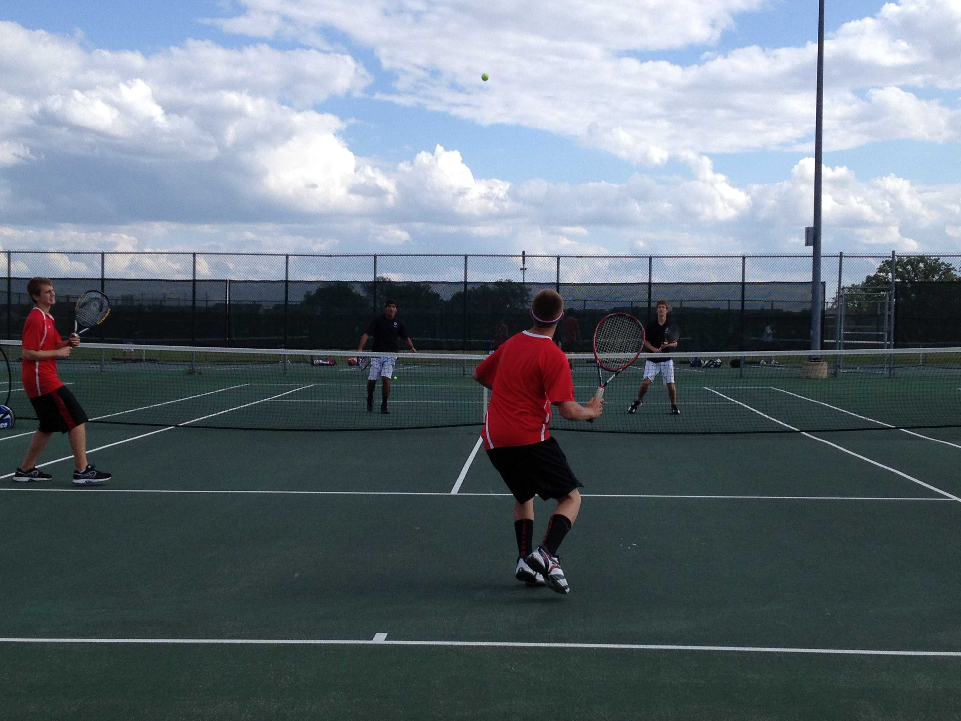 Huntley boys tennis lost to Hampshire on May 7 (K. Garcia).