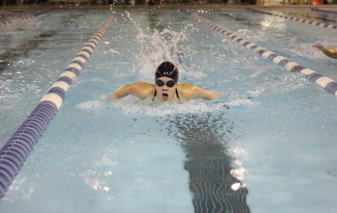 Girls swimming sinks against Jacobs