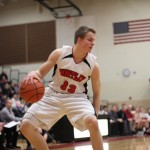 Junior Zach Gorney attempts to dribble past Central defenders. Mike Krebs/The Voice
