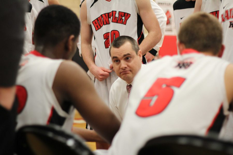 Coach+Martin+Manning+speaks+with+his+players+during+a+timeout.+Mike+Krebs%2F+The+Voice