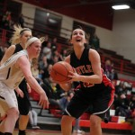 Senior Haley Ream fights to make a lay-up. By Mike Krebs/The Voice