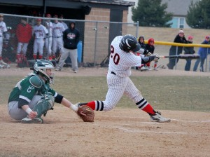 Catcher Mark Skonieczny lines a single up the middle.