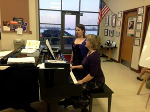 Bailey Kiley sings as her accompanist, Linda Mulcahy, plays piano (H. Baldacci).