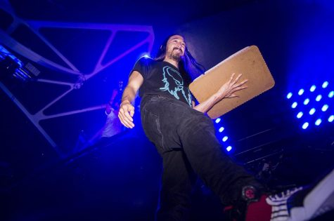 Steve Aoki prepares to cake, or throw a sheet cake, at an audience member during his show at Hakkasan nightclub inside the MGM Grand Hotel & Casino, June 14, 2014 in Las Vegas.