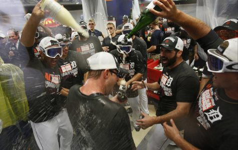 Detroit Tigers players douse a celebrating Max Scherzer in the clubhouse as the team continues their celebration after clinching the American League Central Division after their win over the Minnesota Twins on Sunday, Sept. 28, 2014, at Comerica Park in Detroit. (Julian H. Gonzalez/Detroit Free Press/MCT)