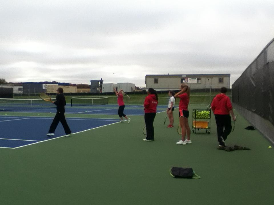 Varsity girls tennis team practices for Conference (M.Iqbal)