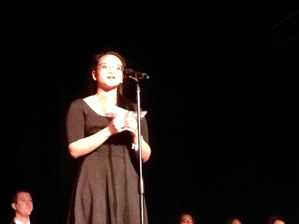 Claudine Garcia inducting a new member to NHS (C. Walsh)