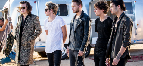 One Direction stands together on set while filming the music video for the new track,