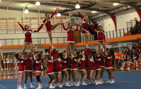 Varsity cheerleading team takes third at CLC invite