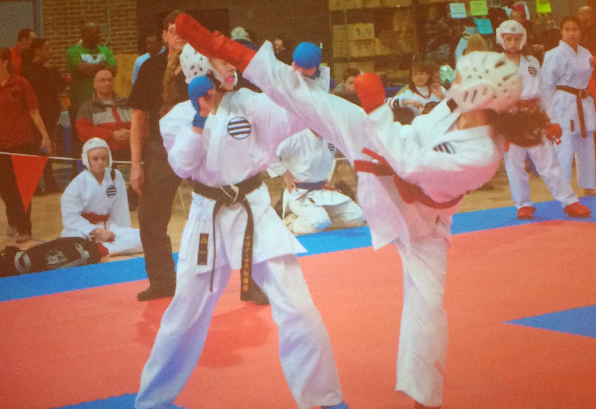 Sophomore Kassidy Mahoney on the right, at the Chicago Classic Karate Tournament in March, 2014.