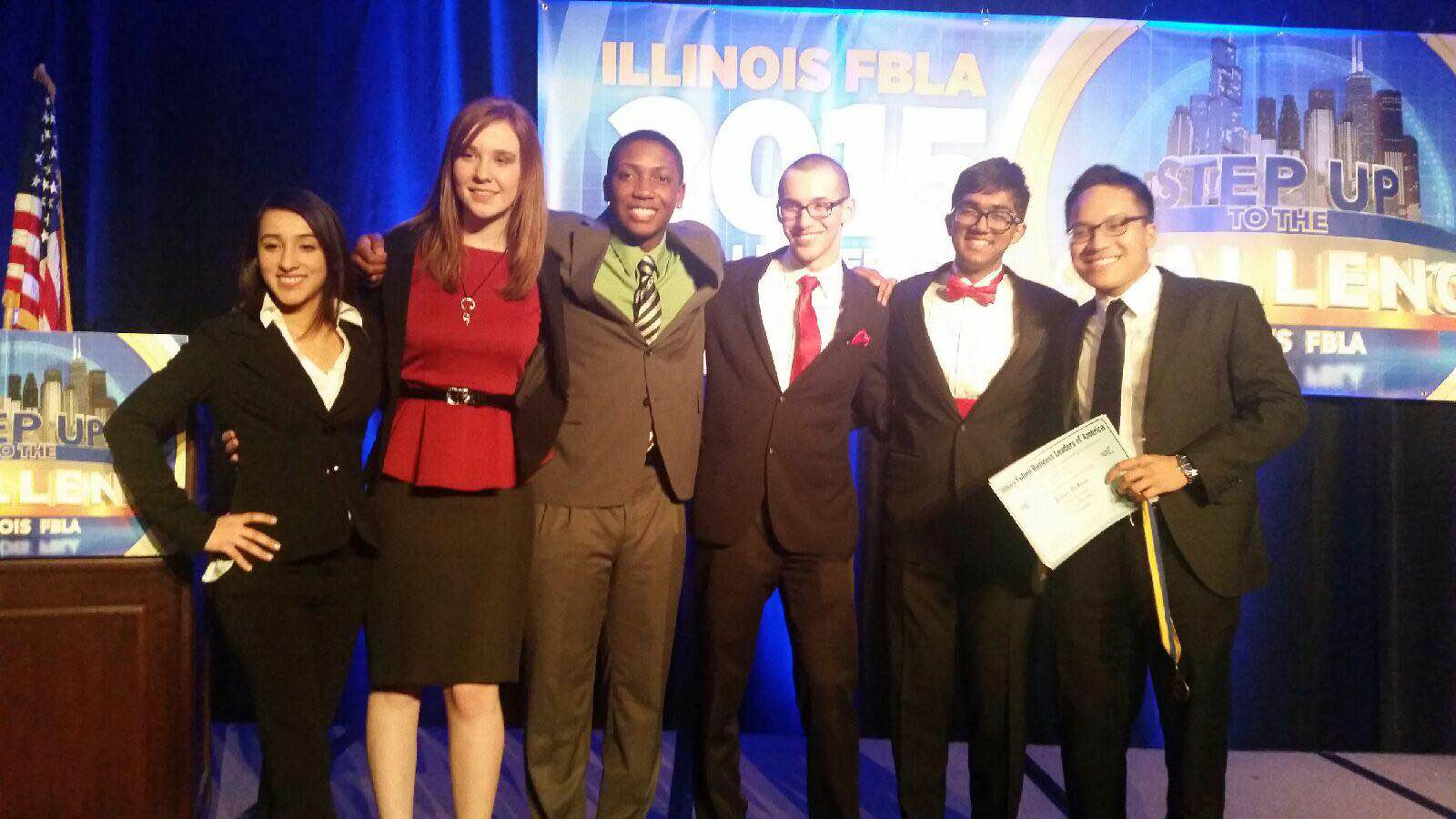All of Huntley's state competition competitors pose together on the state stage (Courtesy of Jestoni Losbanes).