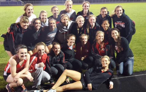 Girls track and field team win conference title
