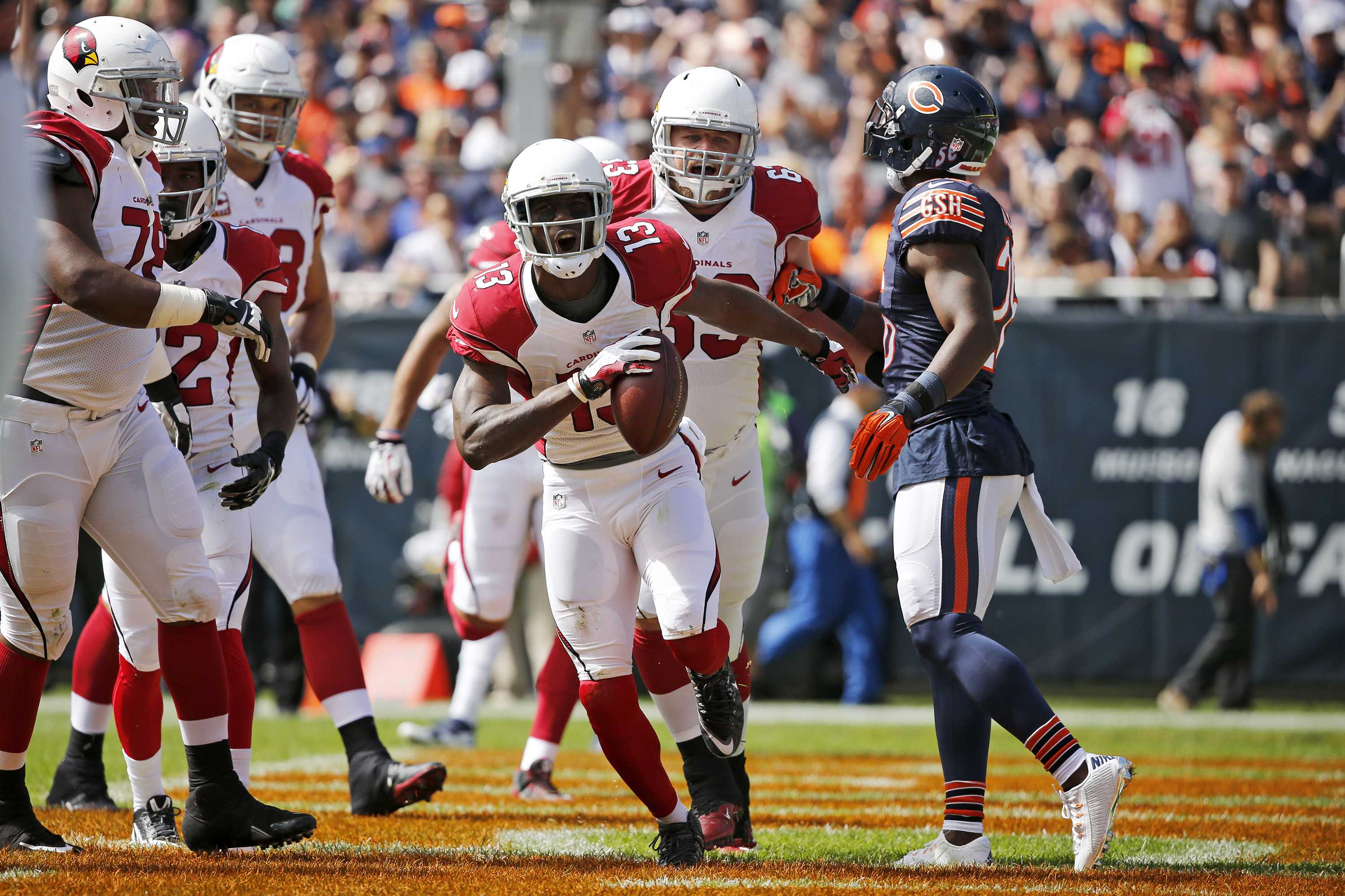 Arizona Cardinals wide receiver Jaron Brown (13) celebrates a touchdown run against the Chicago Bears during the first quarter on Sunday, Sept. 20, 2015, at Soldier Field in Chicago. (Jose M. Osorio/Chicago Tribune/TNS)