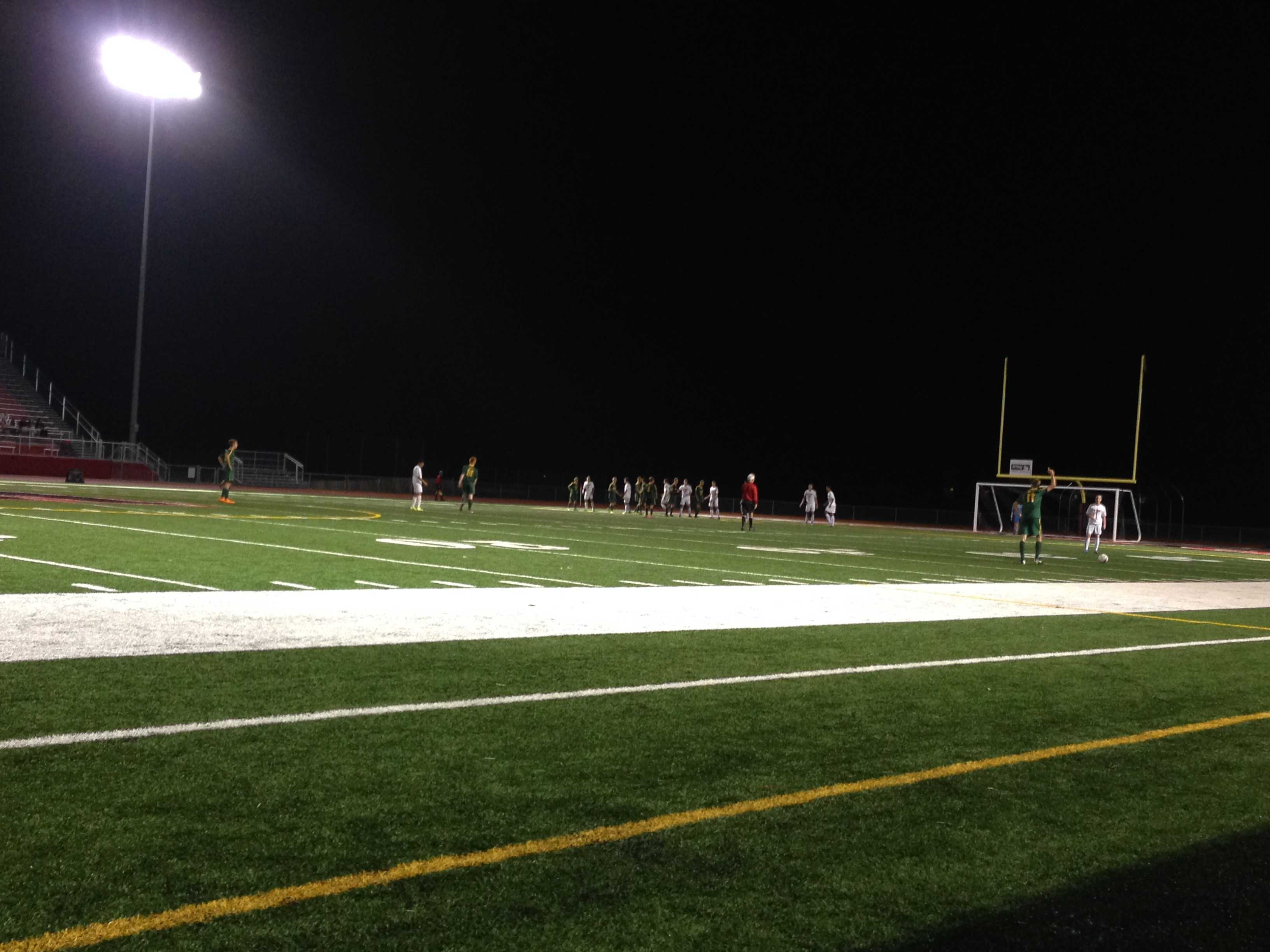 Huntley defends free kick taken by Crystal Lake South.