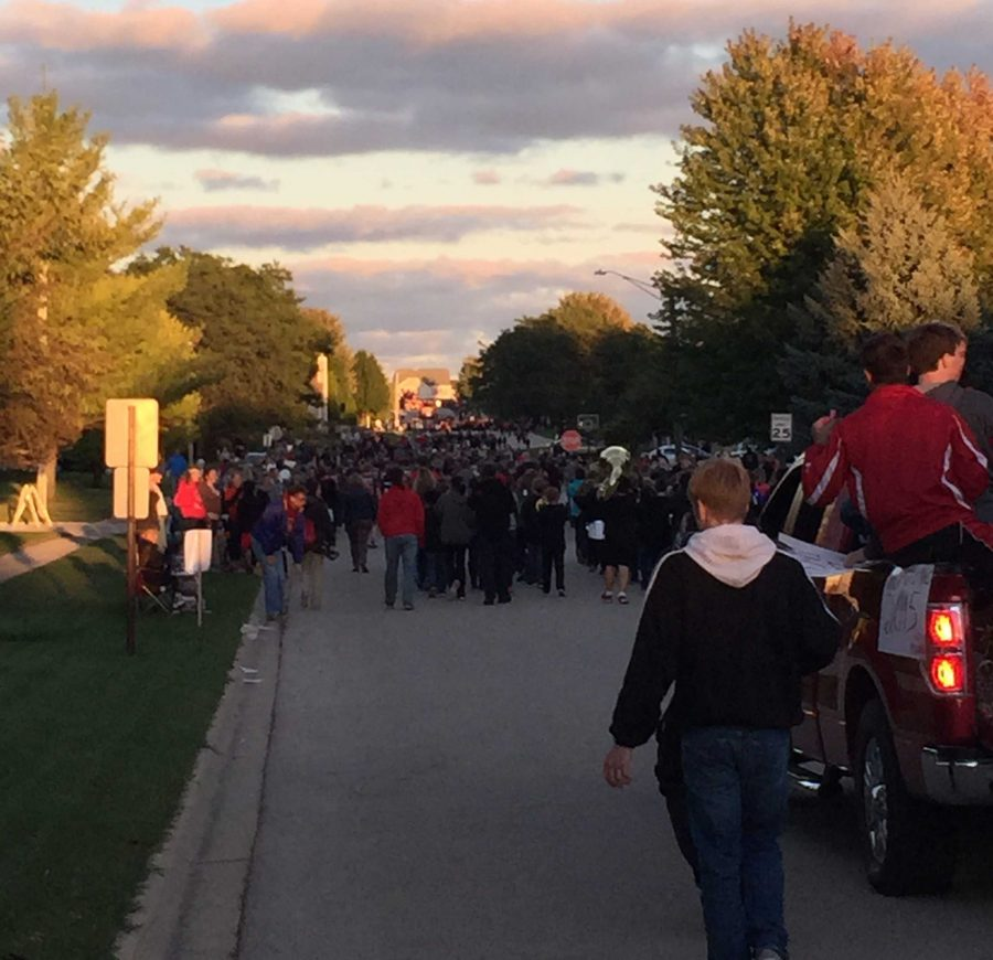 Students+involved+in+clubs+and+sports+show+off+their+Huntley+pride+at+the+annual+Homecoming+Parade.