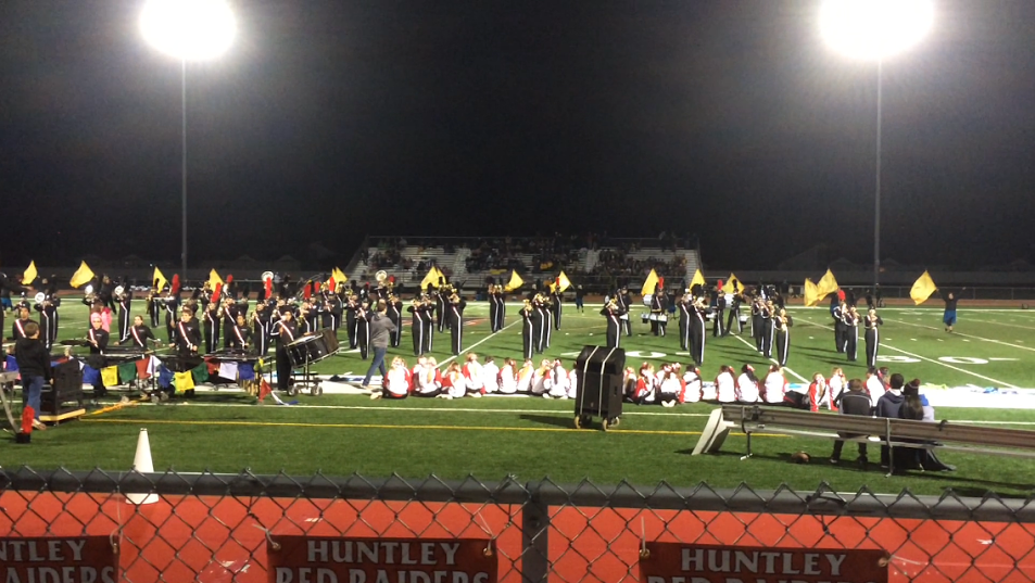 Marching band and color guard at the end of their performance.