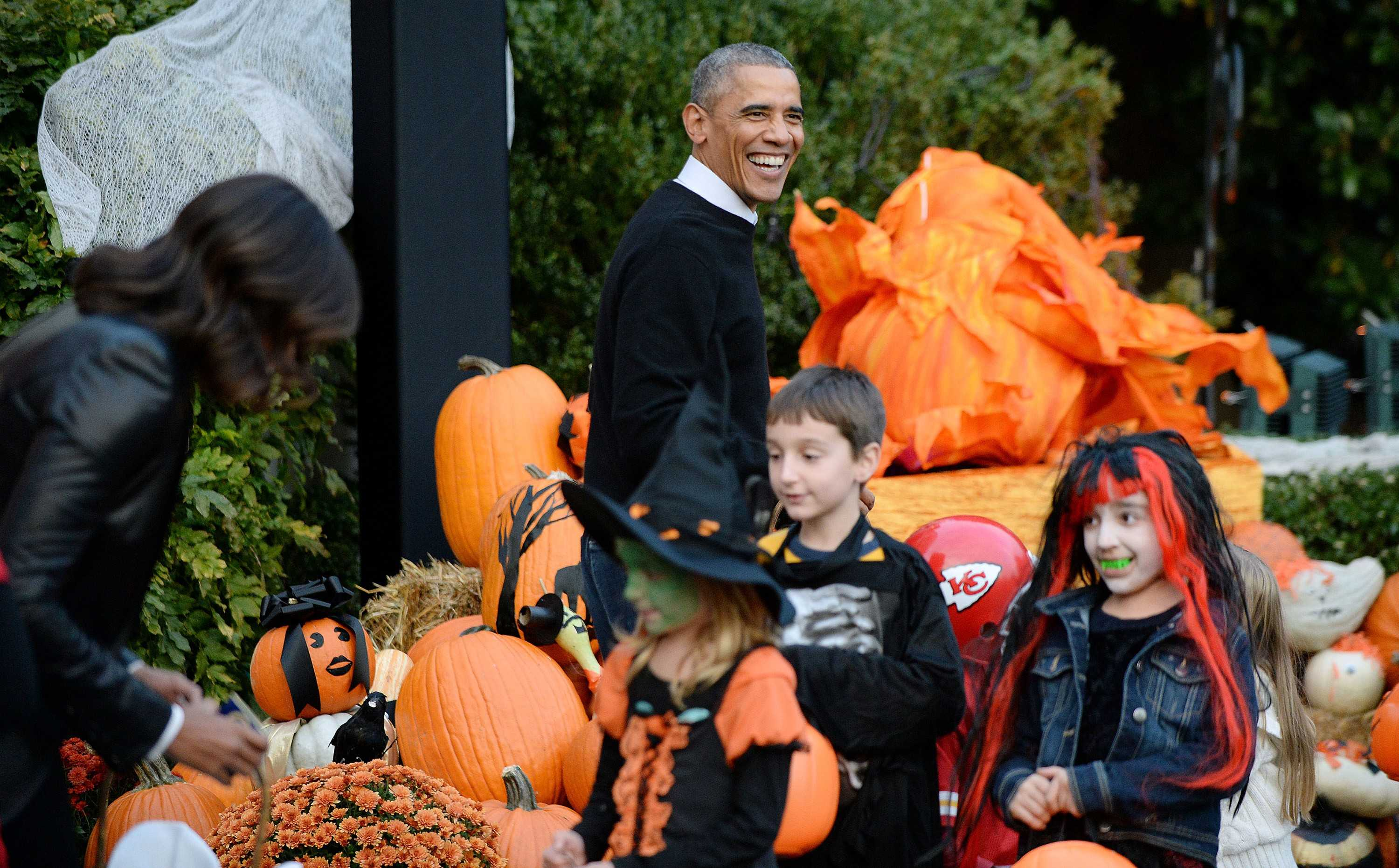 U.S. President Barack Obama and first lady Michelle Obama give out treats to children on the South Lawn of the White House, Oct. 31, 2014 in Washington, D.C. President Obama and First Lady Michelle Obama welcomed local children and children of military families to trick-or-treat for Halloween. (Olivier Douliery/Abaca Press/MCT)