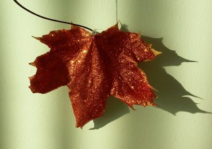 I hung my glitter leaves on my wall with some white thread.