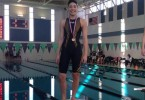 Junior Jacqueline Padal poses with her medal at the Fox Valley Conference meet.