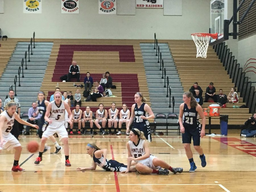 Senior+Paige+Renkosik+chases+down+a+loose+ball+during+Huntley%27s+victory+against+Cary-Grove.