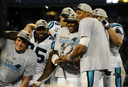 Cam Newton poses with his Carolina Panthers after winning the NFC Championship (Courtesy of MCT Campus).