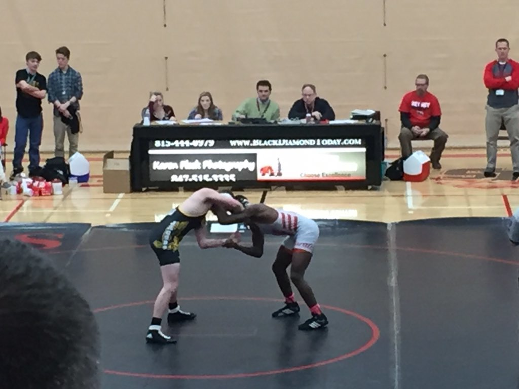 Sophomore Justin Allen grapples with his opponent.