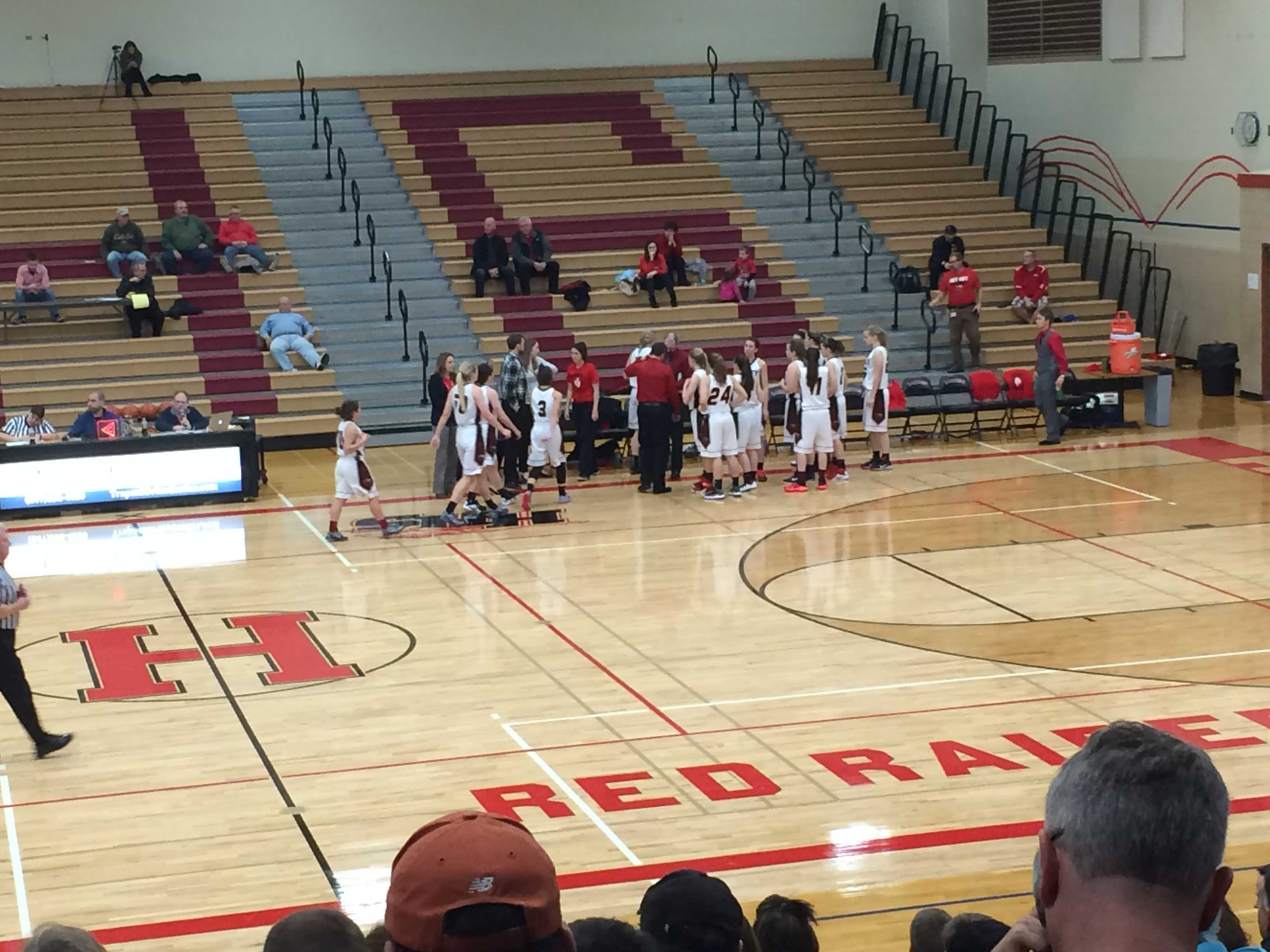 The Red Raiders huddle during their game against CLS.