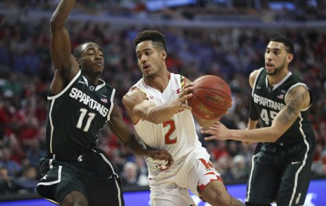 Maryland's Melo Trimble (2) drives against Michigan State's Lourawls Nairn Jr. (11) during the first half in the semfinals of the Big Ten Tournament at the United Center in Chicago on Saturday, March 14, 2015. Michigan State advanced, 62-58. (Armando L. Sanchez/Chicago Tribune/TNS)