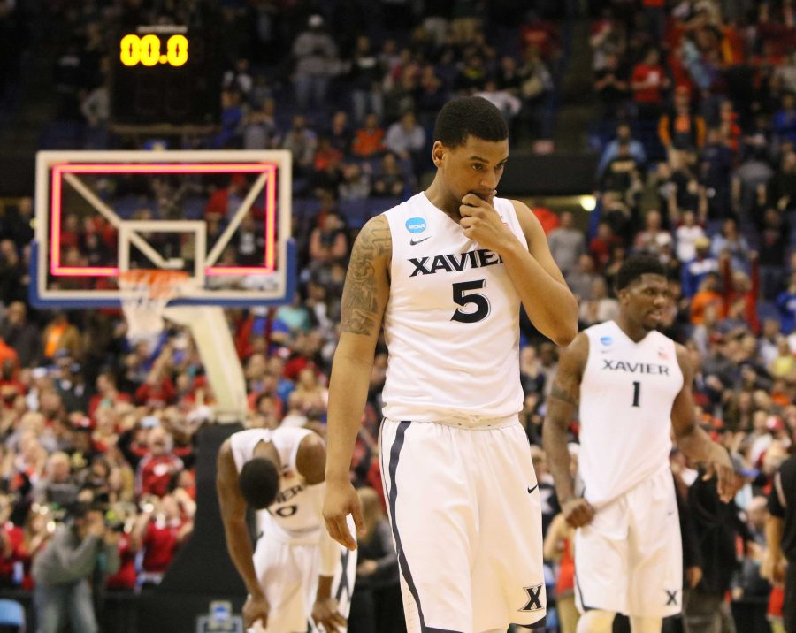 Xavier+players%2C+including+guard+Trevon+Bluiett+%285%29%2C+leave+the+court+after+a+last-second+shot+by+Wisconsin+guard+Bronson+Koenig+beat+them+on+Sunday%2C+March+20%2C+2016%2C+at+the+Scottrade+Center+in+St.+Louis.+%28Chris+Lee%2FSt.+Louis+Post-Dispatch%2FTNS%29
