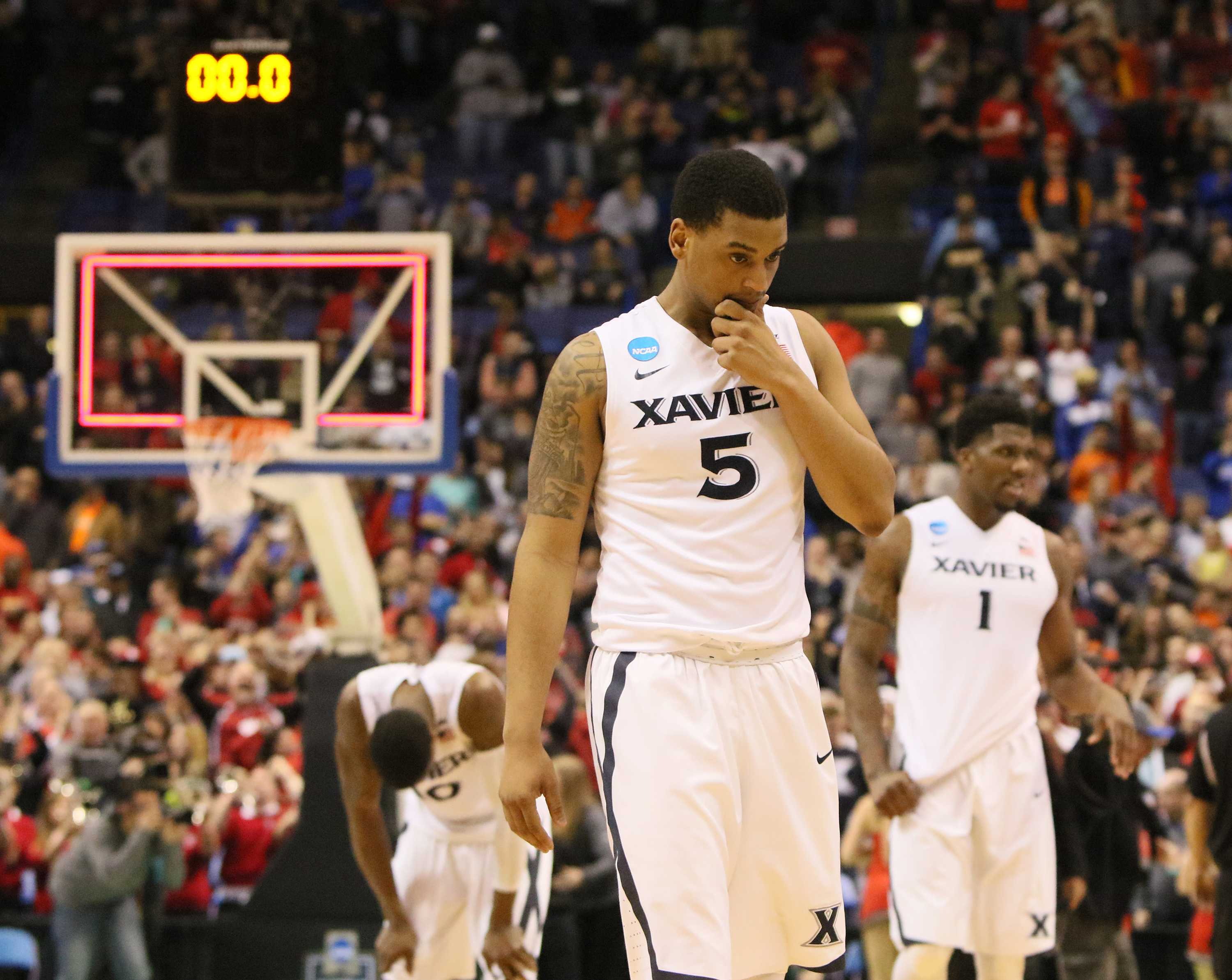 Xavier players, including guard Trevon Bluiett (5), leave the court after a last-second shot by Wisconsin guard Bronson Koenig beat them on Sunday, March 20, 2016, at the Scottrade Center in St. Louis. (Chris Lee/St. Louis Post-Dispatch/TNS)