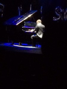 Contestant Joey White plays a song on the piano for the talent portion (S. Biernat).