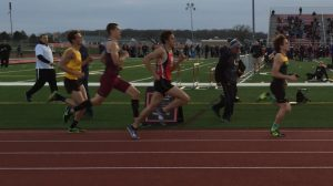 Senior Keagan Smith chases down Jon Prus of Crystal Lake South in his record-setting 800 meter run.