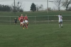 Senior Taryn Jakubowski crosses the ball during the first half. The Red Raiders beat the Hurricanes 3-1.
