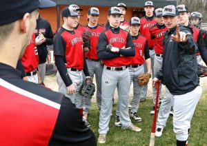 Coach Andy Jakubowski talks to his team before taking the field. The Red Raiders defeated the Indians to win their regional. (courtesy of Rick Bamman/ nwherald.com)