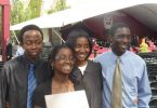 Ayemoba and her siblings at her sister's graduation, where they learned of the surprise trip.