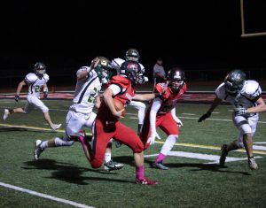 Junior Eric Mooney runs the ball (R. O'Sullivan).