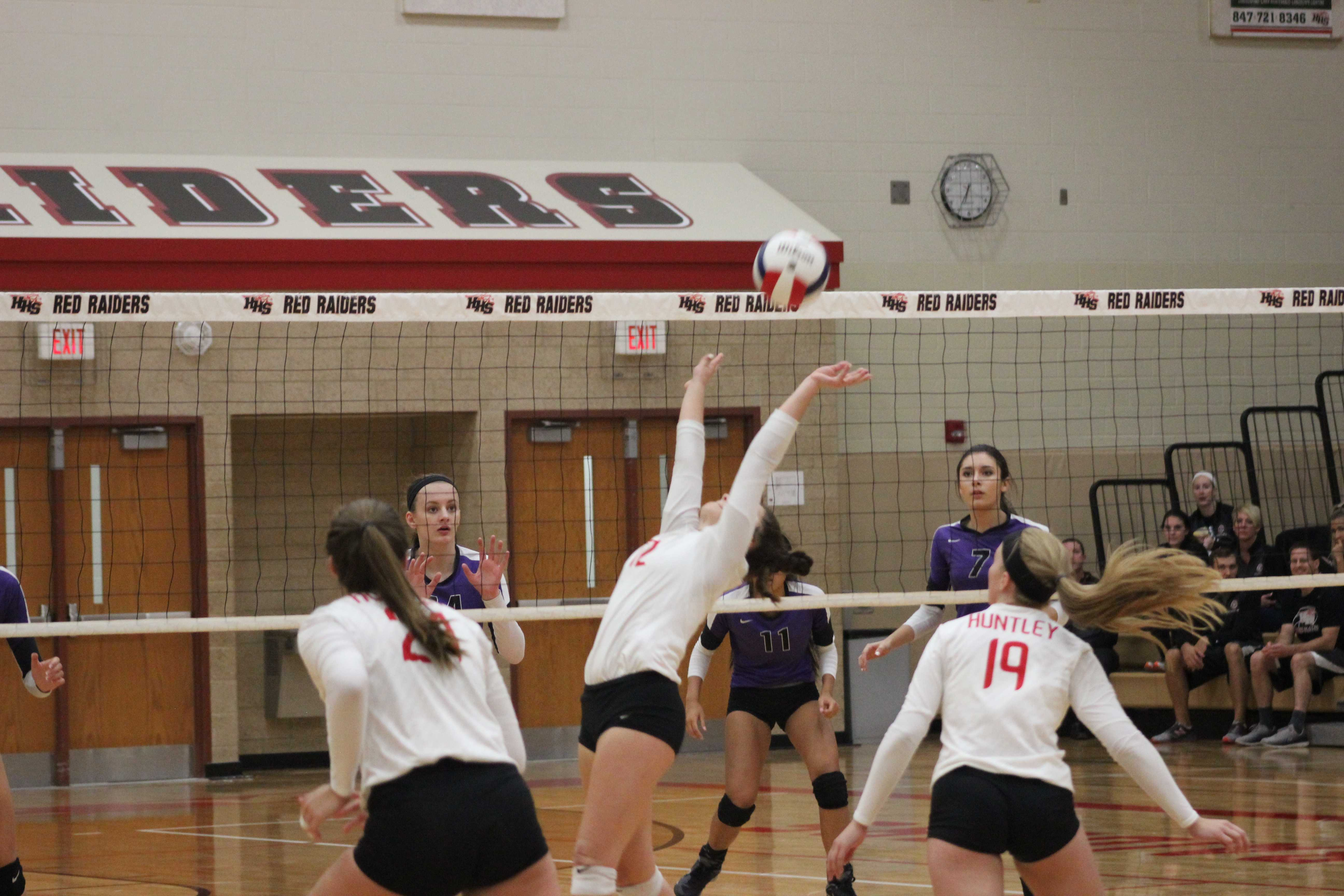 Freshman Taylor Jakubowski sets the ball for one of the hitters (Courtesy of J. Link).