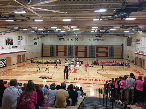 The Huntley red raiders playing volleyball against Crystal Lake South (C. Thomas).