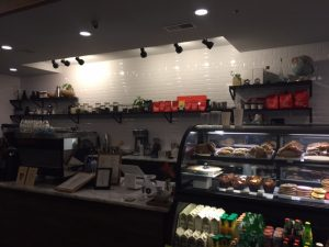 The front counter of Daily Projects with their pastries and sandwiches in the display case (A. Landman).