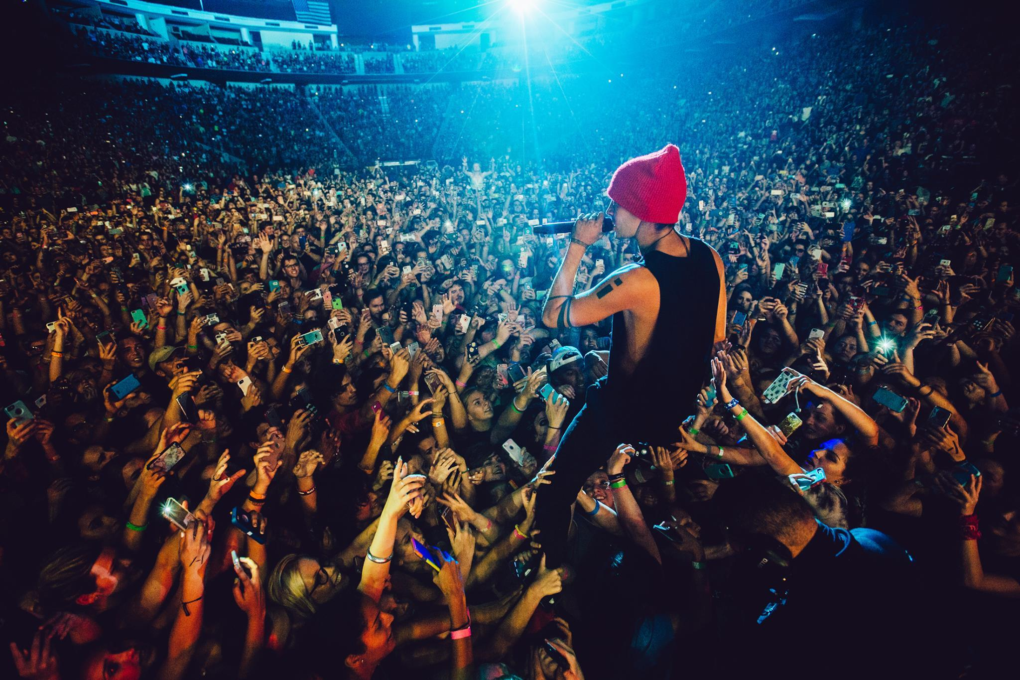 Lead singer, Tyler Joseph, joining the screaming fans as he sings one of their many hit songs (Courtesy of twenty one pilots' Facebook page).