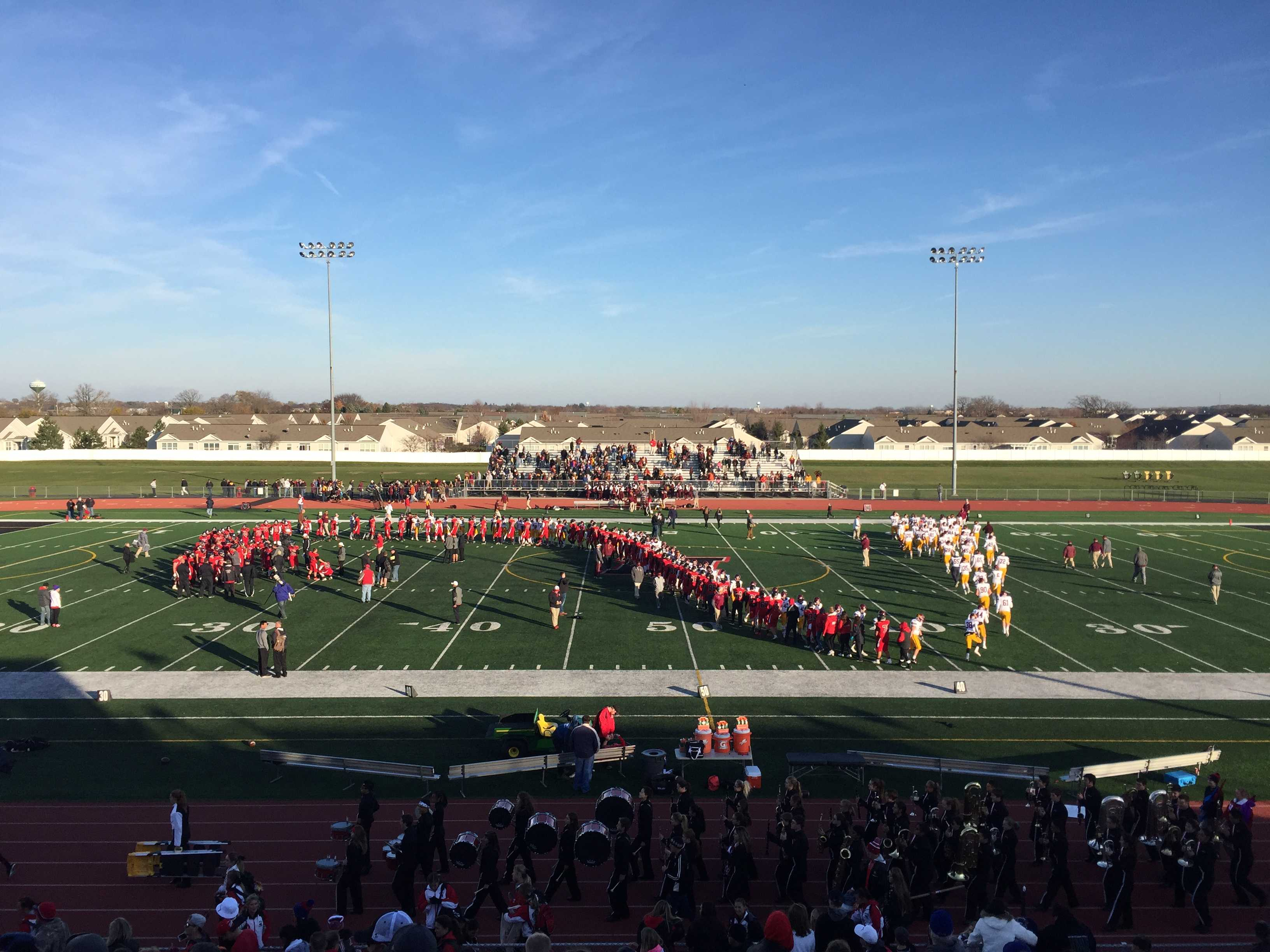 Huntley and Loyola shake hands after Huntley is defeated 24-0. Photo courtesy of Maggie McGee