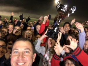 Principal Scott Rowe takes a selfie while students hold up the trophy (S. Rowe)