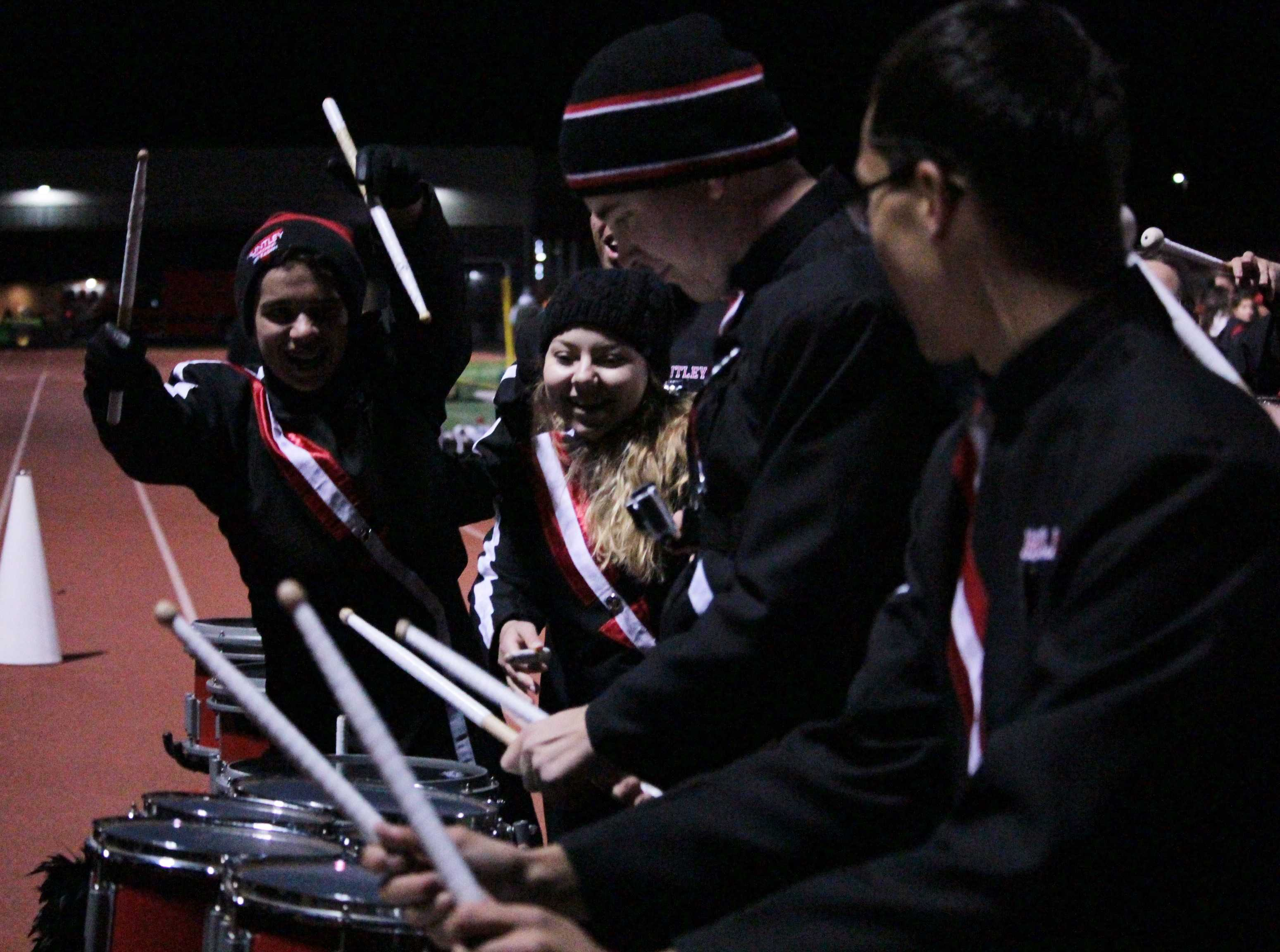 Junior Jack Filpi drumming out, surrounded by his other fellow percussionists (R. O'Sullivan).