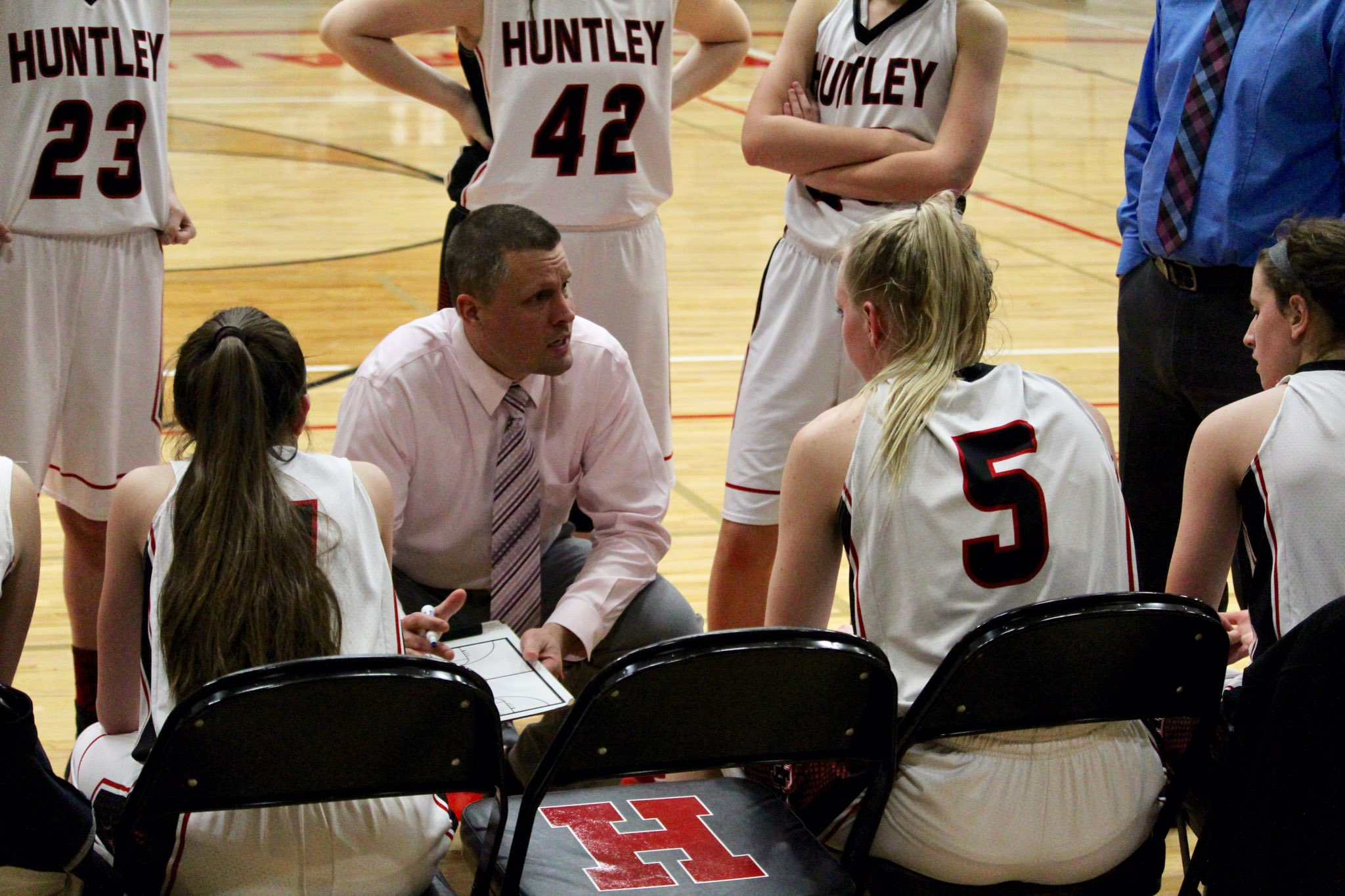 Coach Steve Raethz talks with his team during a timeout. (courtesy of E. Pilat)