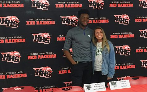 HHS honors two student athletes as they sign their National Letters of Intent